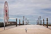 Man running on the central promenade of Odaiba