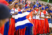 SAN JUAN, PUERTO RICO FEBRUARY 8: Players and coaches for Cuba anxiously stand outside the dugout holding the Cuban flag during the final seconds of the championship game against Mexico on February 8, 2015 in San Juan, Puerto Rico at Hiram Bithorn Stadium(Photo by Jean Fruth)