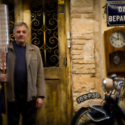 Spiro is one of many lottery seller's in Athens.  The traditional way of selling lottery tickets hasn't changed over the years. Spiro has been doing this job for the past 33 years. Image © Angelos Giotopoulos/Falcon Photo Agency