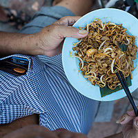 Market vendor's breakfast. Char koay teow, fired rice noodles. Chow Rasta Market, George Town, Penang, Malaysia
