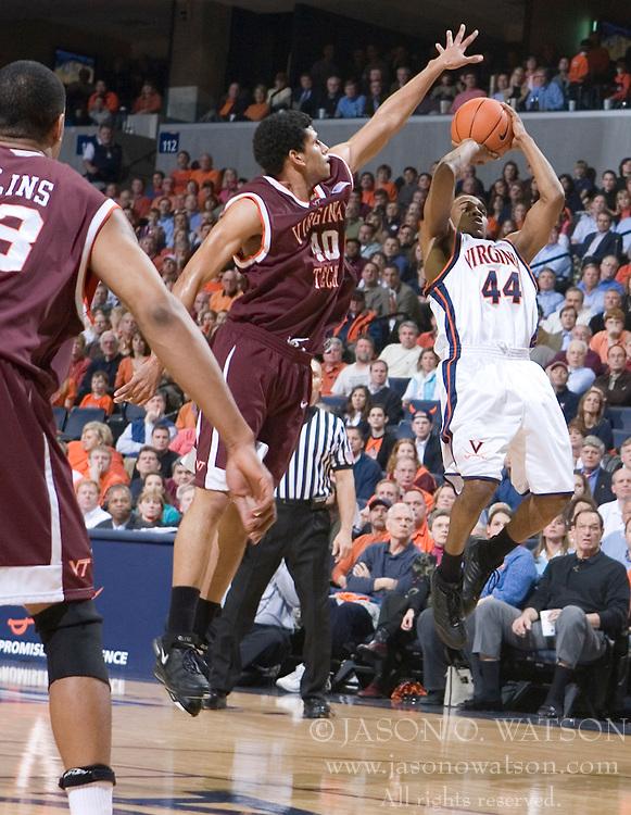 Virginia Cavaliers point guard Sean Singletary (44) shoots a fadeaway jump shot over Virginia Tech Hokies forward A.D. Vasallo (40).  The Virginia Cavaliers Men's Basketball Team defeated the Virginia Tech Hokies 69-56 at the John Paul Jones Arena in Charlottesville, VA on March 1, 2007.