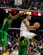 Southern California guard Julian Jacobs, right, goes up for a lay up against Oregon forward Mike Moser in the second half of an NCAA college basketball game Saturday, March 1, 2014, in Los Angeles. Oregon won 78-63.   (AP Photo/Ringo H.W. Chiu)