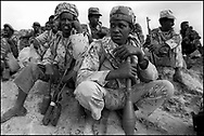 An Eritrean soldier crouches in a trench at the front lines of Tsorona, approximately 60kms south of the capital Asmara, in scenes reminiscent of the First World War. Up to half a million soldiers from both sides face each other along the 1000 km border. Eritrea has been embroiled in a bitter 22 month border war with neighboring Ethiopia in which over 50,000 soldiers have died. .