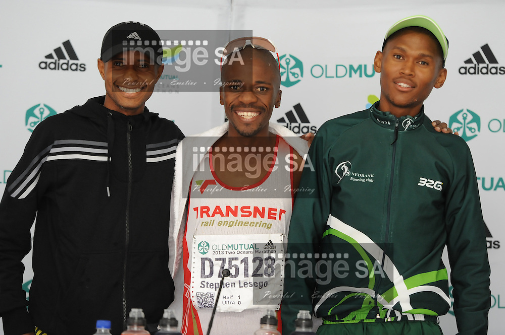 CAPE TOWN, South Africa - Saturday 30 March 2013, From left to right, 2nd place Lusapho April, 1st place Stephen Lesego Mokoka and 3rd place Joel Mmone at the press conference during the half marathon of the Old Mutual Two Oceans Marathon. .Photo by Roger Sedres/ ImageSA