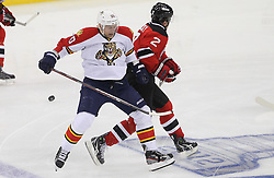 April 24, 2012; Newark, NJ, USA; Florida Panthers left wing Sean Bergenheim (20) and New Jersey Devils defenseman Marek Zidlicky (2) collide during the first period of  game six of the 2012 Eastern Conference quarterfinals at the Prudential Center.
