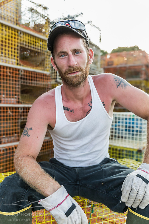 """Ryan Schultz, crew on the lobster boat """"Overkill"""" at the Friendship Lobster Co-op in Friendship, Maine."""