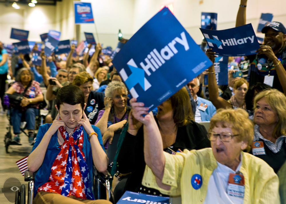 A delegate from the Democratic caucuses covers her ears from the excessive noise as thousands attend the Clark County Convention to elect representatives to the state convention at the Cashman Center on Saturday, April 2, 2016.  L.E. Baskow