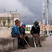 Elderly men relaxing in a courtyard  in San Antonio de Ibarra.