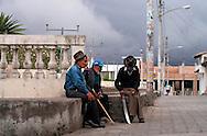 Elderly men relaxing in a courtyard  in San Antonio de Ibarra.