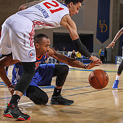 Westchester Knicks Forward DARION ATKINS (5) and Delaware 87ers Center JOHN BOHANNON (21) fight for the loose ball in the second half of a NBA D-league regular season basketball game between the Delaware 87ers and the Westchester Knicks Saturday Dec, 26, 2015 at The Bob Carpenter Sports Convocation Center in Newark, DEL