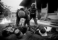 Australian troops, members of Interfet, disarm and arrest members of the Aitarak Militia, Dili East Timor September 21, 1999.