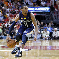 12 March 2011: Memphis Grizzlies point guard Mike Conley (11) dribbles during the Miami Heat 118-85 victory over the Memphis Grizzlies at the AmericanAirlines Arena, Miami, Florida, USA. **