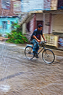 Bicycling in a downpour in Holguin, Cuba.