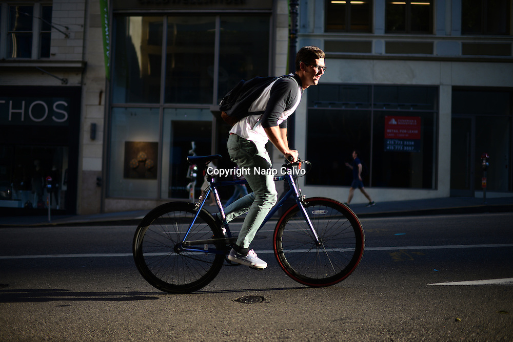 Bicycle rider in steep street of San Francisco.