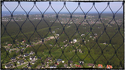 aerial view of tallinn through metal wire