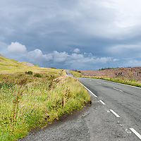 Leaden sky and roadway near the Old Man of Storr.