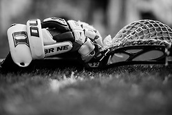 DURHAM, NC - MARCH 16: A detailed view of a lacrosse stick and gloves of the Duke Blue Devils during a game against the Towson Tigers on March 16, 2013 at Koskinen Stadium in Durham, North Carolina. Duke won 12-4.
