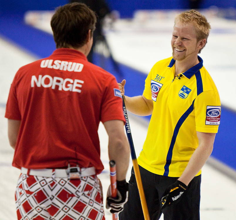 Swedish skip Niklas Edin, right, shares a laugh Norway skip Thomas Ulsrud during their bronze medal match at the Ford World Men's Curling Championships in Regina, Saskatchewan, April 10, 2011.<br /> AFP PHOTO/Geoff Robins