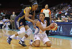 June 3, 2012; Newark, NJ, USA; New York Liberty guard Leilani Mitchell (5) looks to pass while being defended by Indiana Fever guard Briann January (20) during the first half at the Prudential Center.