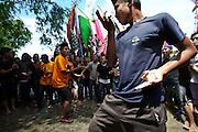 A mock Silat fight on the beach at the Maulid Nabi festival, Cikoang, Sulawesi, Indonesia.