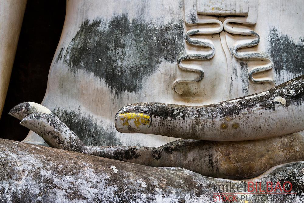 Hand detail in a Buddha statue. Wat Sri Chum. Sukhothai Historical Park. Thailand.