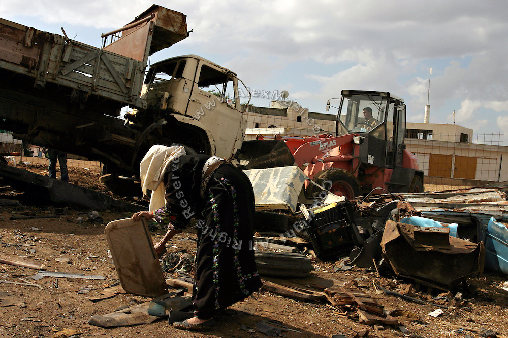 A Bedouin woman is looking for reusable material from a rubbish site on the back of her family's house, in the Bedouin city of Rahat, close to BeerSheva, the capital of the Negev, a large deserted area in the south of Israel. Numbering around 200.000 in Israel, the Bedouins constitute the native ethnic group of these areas, they farm, grow wheat, olives and live in complete self sufficiency. Many of them were in these lands long before the Israeli State was created and their traditional lifestyle is now threatened by subtle Governmental policies. The seven Bedouin towns already built are all between the 10 more impoverished towns in Israel...