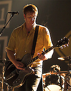 Josh Homme plays a guitar solo during Queens of the Stone Age's set at Cubs Care Park in Chicago, IL. Note the steam coming from his shirt on this cool spring evening.