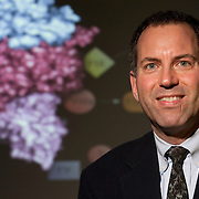 Dr. David A. Roth, M.D., Therapeutic Area Director, Hematology, Wyeth Research,  with an image of the crystal structure of Wyeth's Factor VIII. Cambridge, MA.