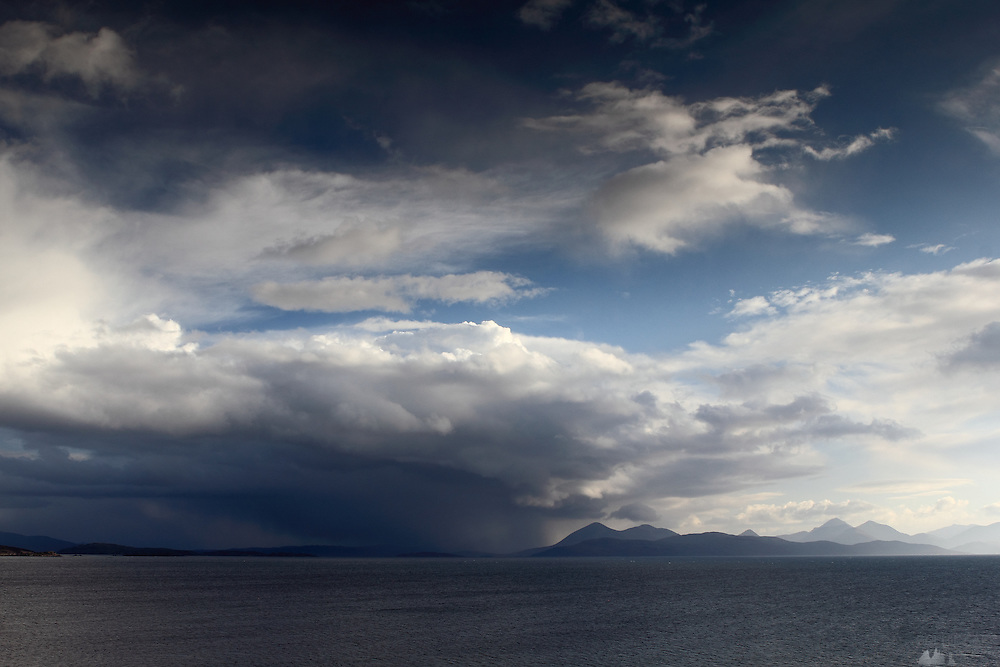 View from the Applecross Peninsula in the north-west Highlands of Scotland, across to stormy skies over the islands of Raasay and Skye