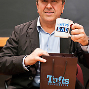 "05/03/2011 - Medford/Somerville, Mass.  Chef Dan Boulud wears a ""Tufts Dad"" hat and holds a ""Jumbos Dad"" mug given to him by the Tufts Culinary Society on Tuesday, May 3, 2011.  Boulud's daughter Alix Boulud, A11, is an undergraduate at Tufts. (Alonso Nichols/Tufts University)."