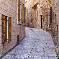 A narrow covered street in the Jewish Quarter of the Old City of Jerusalem. WATERMARKS WILL NOT APPEAR ON PRINTS OR LICENSED IMAGES.