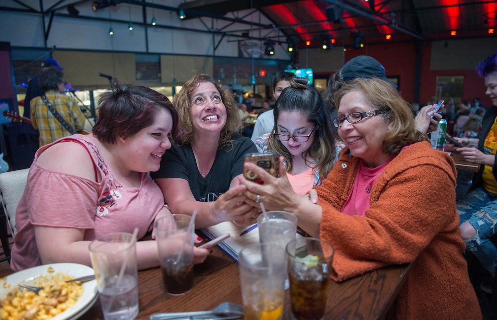 em050217h/a/From left, Isabella Mendoza, Amber Trujillo, Gabriella Mendoza and Mary Ann Soto watch results of the soda tax election come in. They were at a party by Smart Progress New Mexico at the Boxcar in Santa Fe, Tuesday May 2, 2017. Trujillo is the wife of City Councilor Ron Trujillo. (Eddie Moore/Albuquerque Journal
