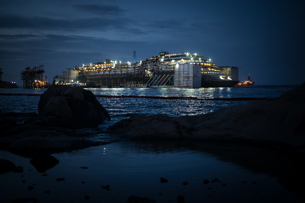 Costa Concordia re floated wreck is seen at night from the Giglio Island coast. The ship will be removeed in two days an towed to the scrap yard in Genoa
