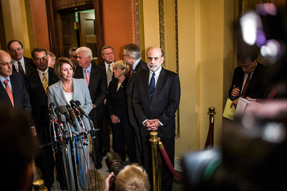 Federal Reserve Chairman Ben Bernanke (center) appears at a news conference with House Speaker Nancy Pelosi (D-CA) and Treasury Secretary Henry Paulson (left) following a meeting on Capitol Hill on Thursday, September 18, 2008 in Washington, DC. Brendan Hoffman for the New York Times