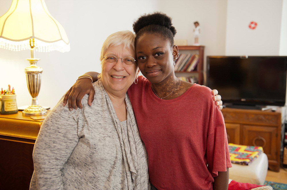 """Michaela DePrince at her home in Manhattan. ..vrnl: Adoptivmutter Elaine DePrince und Michaela DePrince...Michaela DePrince was born in war-torn Sierra Leone on January 6, 1995 where she was named Named Mabinty Bangura. Her adoptive parents were told that her father was shot by rebels when she was three years old, and that her mother starved to death soon after. Frequently malnourished, mistreated, and derided as a """"devil's child"""" because of vitiligo, a skin condition causing depigmentation, she fled to a refugee camp after her orphanage was bombed. In 1999, at age four, she and another girl, Mia, were adopted by Elaine and Charles DePrince from New Jersey, and taken to the United States. (source: Wikipedia)..Photo © Stefan Falke.www.stefanfalke.com"""
