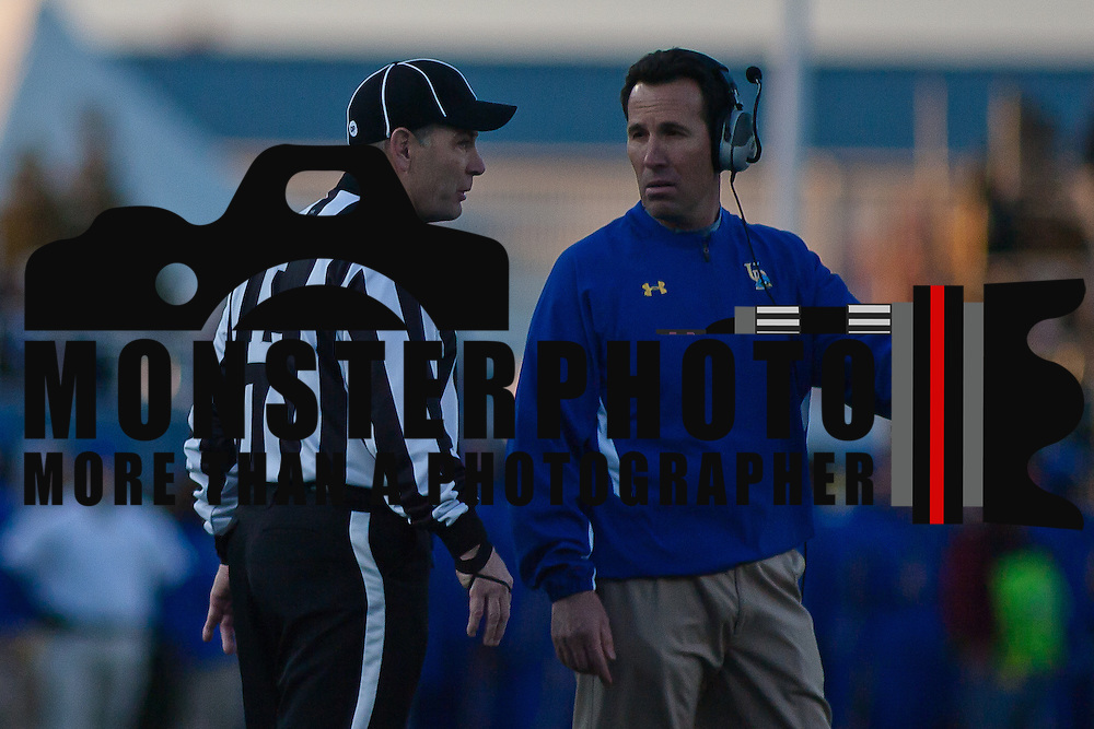11/11/11 Newark DE: Delaware head coach K.C. Keeler attempts to discuss a game situation with the game official during a Week 10 NCAA football game.<br /> <br /> Delaware defeated Richmond 24-10 in front of 18, 808 fans at Delaware Stadium on Saturday Nov. 12, 2011 in Newark Delaware...Special to The News Journal/SAQUAN STIMPSON