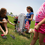 Left to right, Christian Edwards, 17, Skyler Edwards, 12, and Hailey Edwards, 7, of Howe .visit and decorate their uncle's grave after the Memorial Day Ceremony at the Dallas-Fort Worth National Cemetery May 31, 2010. Army Staff Sgt. Clay A. Craig died April 29, 2008, serving during Operation Iraqi Freedom. (Courtney Perry/The Dallas Morning News). 06012010xMETRO