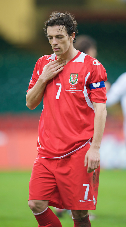 CARDIFF, WALES - Wednesday, April 1, 2009: Wales' captain Simon Davies walks off dejected after his side's 2-0 defeat by Germany during the 2010 FIFA World Cup Qualifying Group 4 match at the Millennium Stadium. (Pic by David Rawcliffe/Propaganda)