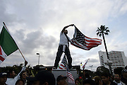 Reyes Van Den Hengel waves both the American and Mexican flags together at the National Day of Action demonstration in Los Angeles, CA on Monday, April 10, 2006.<br />