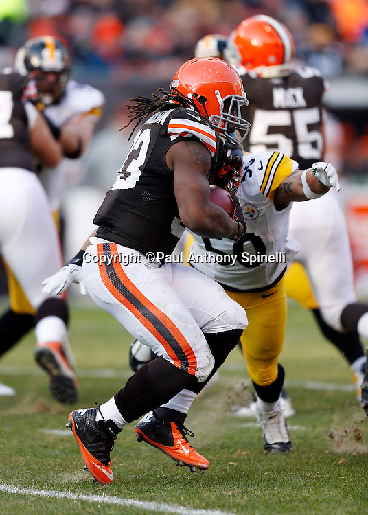 Cleveland Browns running back Trent Richardson (33) avoids a tackle attempt by Pittsburgh Steelers inside linebacker Larry Foote (50) as he runs the ball during the NFL week 12 football game against the Pittsburgh Steelers on Sunday, Nov. 25, 2012 in Cleveland. The Browns won the game 20-14. ©Paul Anthony Spinelli