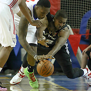 "Delaware 87ers Forward Keith ""Tiny"" Gallon (41) steals the ball from Austin Toros Center Dexter Pittman (32) in the course of a NBA D-league regular season basketball game between the Delaware 87ers (76ers) and the Austin Toros (Spurs) Monday, Jan. 27, 2014 at The Bob Carpenter Sports Convocation Center, Newark, DE"
