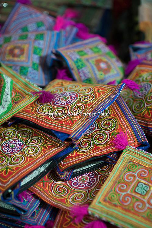 Colorful souvenir purses in the markets of Sapa, Vietnam.