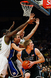 Nov 21, 2008; New York, NY, USA; Duke Blue Devils forward Kyle Singler (12) looks to put back a rebound during the 2K Sports Classic Championship game at Madison Square Garden.