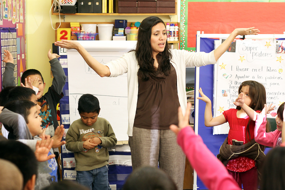 Liza Veliz-Torres teaches kindergartners at Washington Elementary School in Woodburn on Thursday, Dec. 1, 2011.