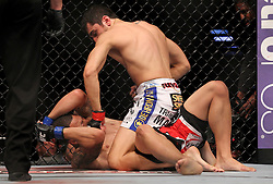 Atlantic City, NJ - June 22, 2012: Ramsey Nijem (white trunks) and C.J. Keith (red/black trunks) at UFC on FX 4 at Ovation Hall at Revel Resort & Casino in Atlantic City, New Jersey.