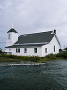 A church on Hoopers Island has waves from the Chesapeake lapping up against the back side of the building during high tide. Every year the water gets a little closer and there are few places left to move.