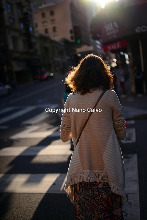 Woman in crosswalk, San Francisco.