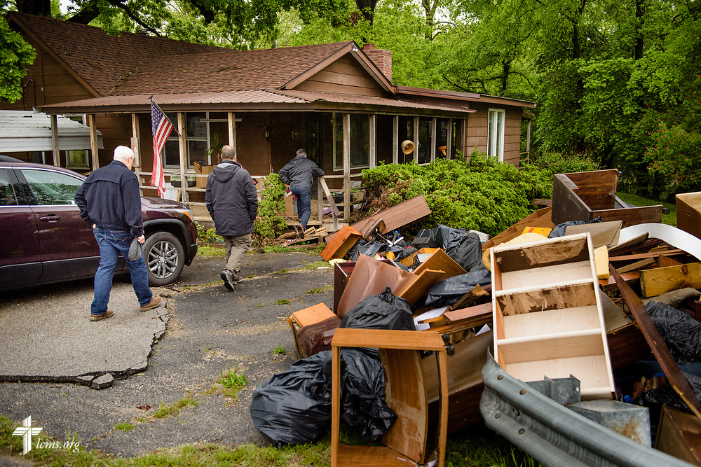 (From Left to right) The Rev. Greg Mech, pastor of Immanuel Lutheran Church, Joplin, Mo., the Rev. Michael Meyer, manager of LCMS Disaster Response, and the Rev. Steve Gillmore, pastor of First Lutheran Church, Neosho, Mo., check on the welfare of church member Dick Keezer at his flood-damaged home on Wednesday, May 3, 2017, in Neosho. LCMS Communications/Erik M. Lunsford