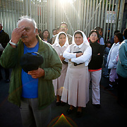 Faithful pray as they see the statue at the Our Lady of Guadalupe Basilica during a mass celebrating the Santa Fe-bound statue. The statue was commissioned by the historic Our Lady of Guadalupe church in Santa Fe, New Mexico. The statue was commissioned and funds raised after a controversial state-sponsored art exhibit that pushed the boundaries of the sacred and traditional image of Our Lady of Guadalupe. The statue was loaded onto a flatbed truck and driven north, following El Camino Real, the ancient route the Spanish settlers took north to settle New Mexico and the RIo Grande valley.