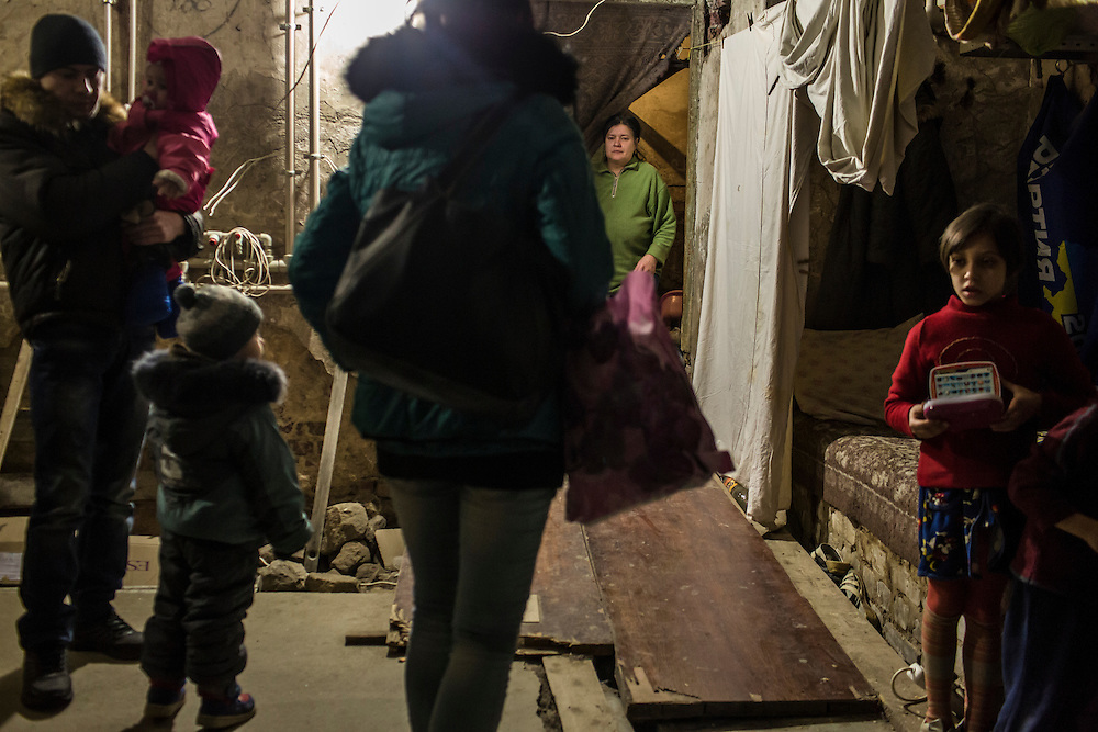 DONETSK, UKRAINE - JANUARY 29, 2015: Local residents inside an underground bomb shelter where they have been living in the Petrovskyi district of Donetsk, Ukraine. The neighborhood has been shelled heavily in the past few days, forcing many people back to the shelters they first fled to in the summer. CREDIT: Brendan Hoffman for The New York Times